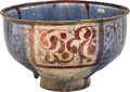 Ceramics & Porcelain, A Persian Blue Glazed Earthenware Bowl, 16th century, possibly earlier. 4-1/4 x 7 x 7 inches (10.8 x 17.8 x 17.8 cm). ...