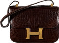 "Luxury Accessories:Bags, Hermès 23cm Cafe Porosus Crocodile Constance Bag with Gold Hardware. J Circle, 1980. Condition: 3. 9"" Width x 7"" H..."
