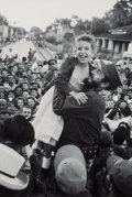Photographs:Digital, After Burt Glinn (American, 1925-2008). On another stop, Castro lifts a young admirer, 1959. Digital pigment print, prin...