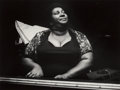 Photographs:Gelatin Silver, Michelle Vignes (French, 1926-2012). Beverly Stovall Playing the Blues, 1984. Gelatin silver, printed later. 9 x 11-7/8 ...