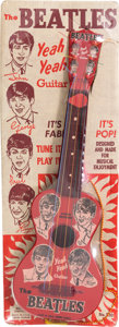 Music Memorabilia:Memorabilia, The Beatles Yeah Yeah Guitar on Backing Card (1964). . ...
