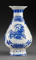 Ceramics & Porcelain, A Chinese Blue and White Porcelain Vase, 20th century. Marks: Six-character Kangxi mark in underglaze blue, and of a later p...