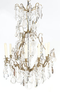 A Cut Glass, Rock Crystal, and Brass Chandelier, 20th century 51 x 25 inches (129.5 x 63.5 cm)