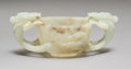 Carvings, A Chinese Carved Celadon Jade Twin-Handled Cup, . Qing Dynasty, 17th century. 2-1/4 x 5-3/4 x 2-7/8 inches (5.7 x 14.6 x 7.3...