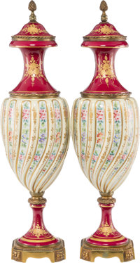 A Pair of Sèvres-Style Partial Gilt Porcelain Covered Urns on Bronze Bases, possibly France, 19th century Marks:...