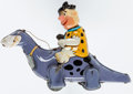 Toys:Miscellaneous, Fred Flintstone on Dino Wind-Up Toy (Marx, 1960s)....