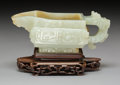 Carvings, A Chinese Archaistic Carved White Jade Pouring Vessel on Fitted Hardwood Stand, Qing Dynasty, 18th-19th century. 3-5/8 x 5-7...