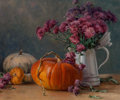 Paintings:20th Century, Clyde Aspevig (American, b. 1951). Pumpkins and Mums. Oil on canvasboard. 19-7/8 x 23-3/4 inches (50.5 x 60.3 cm). Signe...