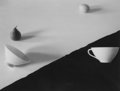 Photographs:Platinum-palladium, Jed Devine (American, b. 1944). Pear, Lemon, and Two Cups on Black and White Paper. Palladium on Japanese Rice Paper. 7-...