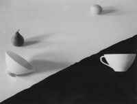 Jed Devine (American, b. 1944) Pear, Lemon, and Two Cups on Black and White Paper Palladium on Japan