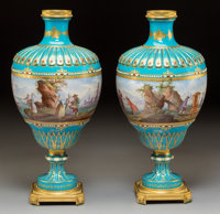 A Pair of French Sèvres-Style Partial Gilt, Enamel Jeweled, and Gilt Bronze-Mounted Porcelain Urns, third quarter...