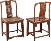 A Pair of Chinese Hongmu Hardwood Yoke-Back Chairs, late 19th century 39-1/4 x 19 x 16 inches (99.7 x 48.3 x 40.6 cm)...