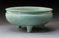 A Chinese Incised Longquan Tripod Censer, late Ming Dynasty 5-3/4 x 13 x 13 inches (14.6 x 33.0 x 33.0 cm)