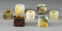 A Group of Seven Chinese Carved Jade and Hardstone Thumb Rings, Qing Dynasty, 18th-19th century 1-3/8 x 1-1/4 x 1-