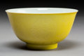 Ceramics & Porcelain:Chinese, A Fine Chinese Incised Yellow Ground Porcelain Bowl, Qing Dynasty. Marks: Six-character Kangxi mark in blue underglaze and p...
