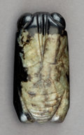 Carvings, A Chinese Black and Pale Green Mottled Jade Cicada, Ming Dynasty. 5/8 x 2-3/4 x 1-1/4 inches (1.6 x 7.0 x 3.2 cm). ...