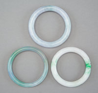 Three Chinese Carved Jadeite Bracelets, Qing Dynasty 3-1/8 x 3-1/8 x 0-1/2 inches (7.9 x 7.9 x 1.3 cm) (largest)