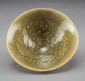 Ceramics & Porcelain:Chinese, A Chinese Yaozhou Ware Tea Bowl with Double Phoenix Decoration, Northern Song-Jin Dynasty, 11th-12th century . 1-3/4 x 4-3/8...
