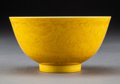 Ceramics & Porcelain:Chinese, A Chinese Incised and Yellow Glazed Porcelain Bowl, Qing Dynasty, Jiaqing Period. Marks: Six-character Jiaqing mark and of t...