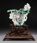 Carvings:Chinese, A Large Chinese Carved Jadeite Floral and Figural Group on Carved Hardwood Stand. 9-1/2 x 9-1/4 x 3 inches (24.1 x 23.5 x 7....