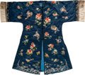 Textiles, A Chinese Blue Ground Embroidered Floral Silk Robe, late Qing Dynasty. 45 x 52 inches (114.3 x 132.1 cm). ...