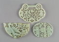 Carvings, Three Chinese Carved and Pierced Jade Buckles, Qing Dynasty. 3-1/2 x 2-5/8 inches (8.9 x 6.7 cm). ... (Total: 3 Items)