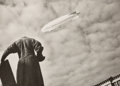 Photographs:Gelatin Silver, Yakov Khalip (Russian, 1908-1980). The New Soviet Dirigible over the Streets of Moscow, circa 1935. Gelatin silver. 5-3/...