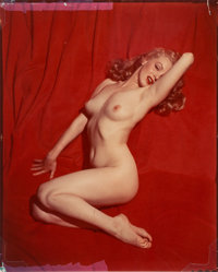 Tom Kelley (American, 1914-1984) Marilyn Monroe on Red Velvet, Pose #1, 1949 Dye coupler, 1960s 9-3/4 x 7-5/8 inches