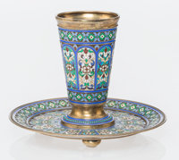 A Russian Cloisonné Enameled and Gilt Silver Cup and Saucer, Moscow, mid-late 19th century Marks: (double headed...