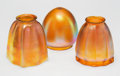 Art Glass:Other, A Group of Three Quezal Art Glass Shades, early 20th century. Marks: Quezal . 5 x 4 x 4 inches (12.7 x 10.2 x 10.2 cm) (... (Total: 3 Items)