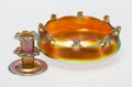 Art Glass, A Tiffany Studios Favrile Glass Flower Frog and a Steuben Gold Aurene Glass Centerbowl, early 20th century. Marks to flower ... (Total: 2 Items)