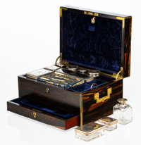 An English Macassar Ebony and Brass Dressing Box with Glass and Silver Toilette Articles, late 19th century Marks