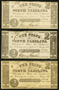 Obsoletes By State:North Carolina, Raleigh, NC- State of North Carolina $2 Oct. 6, 1861 Cr. 22 Three Examples Very Fine (2); Crisp Uncirculated.. ... (Total: 3 notes)