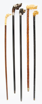 A Group of Five English Carved Dog Figure Walking Sticks, late 19th century Marks to presentation cane: EN<