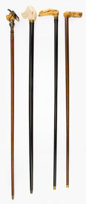 A Group of Four English and German Dog Figure Walking Sticks, early 20th century 36 x 2-1/4 x 2-3/4 inches (91.4 x