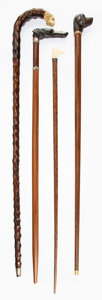 Decorative Accessories, A Group of Four English Carved Dog Figure Walking Sticks, late 19th century. 36 inches (91.4 cm) (tallest). ... (Total: 4 Items)