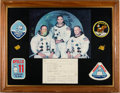 Explorers:Space Exploration, Apollo 11: Flown Kapton Foil Segments, First Moon Rock Report, and Michael Collins Signed Photo, in Framed Display. ...