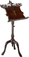 Furniture , A Continental Art Nouveau Carved Mahogany Music Stand, circa 1900. 55 x 24-5/8 x 21-1/4 inches (139.7 x 62.5 x 54.0 cm). ...