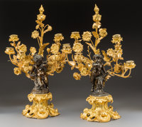 A Pair of Louis XV-Style Gilt and Patinated Bronze Figural Six-Light Candelabra, late 19th century 26 x 16-1/2 in