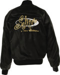 "Music Memorabilia:Costumes, Selena Black Satin Tour Jacket. A size Small black satin jacketwith ""Selena y los Dinos"" logo embroidered on the back in wh..."