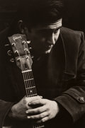 Photographs:Gelatin Silver, Jim Marshall (American, 1936-2010). Phil Ochs, 1963. Gelatin silver, 1990. 11 x 7-1/4 inches (27.9 x 18.4 cm). Signed, t...