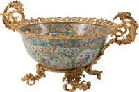 A Chinese Rose Medallion Porcelain Center Bowl with Gilt Bronze Mounts, late 19th century 17 x 33 x 24 inches (43