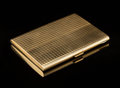 Silver & Vertu, An American 18K Gold Basket-Weave Cigarette Case with Leather Case, circa 1930. Marks: (diamond-750). 4-3/8 x 3-1/4 x 3/8 in...