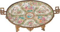A Chinese Rose Medallion Porcelain Charger with Gilt Bronze Mounts, late 19th century 6-1/2 x 17-1/2 x 11-1/2 inch