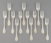 Twelve Tiffany & Co. Japanese Pattern Silver Oyster Forks, New York, designed 1871 Marks to each: TIFFANY &a...