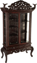 Furniture, A Japanese Carved Hardwood Vitrine, early 20th century. 85-1/2 x 47 x 19 inches (217.2 x 119.4 x 48.3 cm). .....