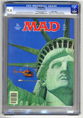 "Magazines:Humor, Mad #252 Gaines File pedigree (EC, 1985) CGC NM 9.4 Off-white towhite pages. ""Family Ties"" parody. Cover by ""Armanli"" (Doug..."