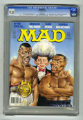 """Magazines:Mad, Mad #297 (EC, 1990) CGC NM/MT 9.8 White pages. Mort Drucker coverparodies Buster Douglas, Don King, and Mike Tyson. """"The Hu..."""