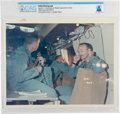 """Explorers:Space Exploration, Apollo 11: Original NASA """"Red Number"""" Color Photo of Neil Armstrong Playing the Ukulele in the Mobile Quarantine Facility, Jul..."""