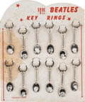 Music Memorabilia:Memorabilia, The Beatles Treasure Chest Key Rings With Easel Back Card (1964). ...
